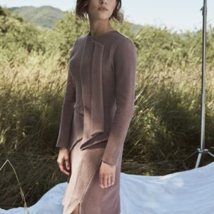 Benedetta dress, with a soft and glided line along the body, made of regenerated cashmere.